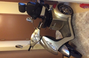 Like new gold 3 wheel  electric mobility scooter