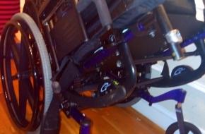 Gliding wheelchair